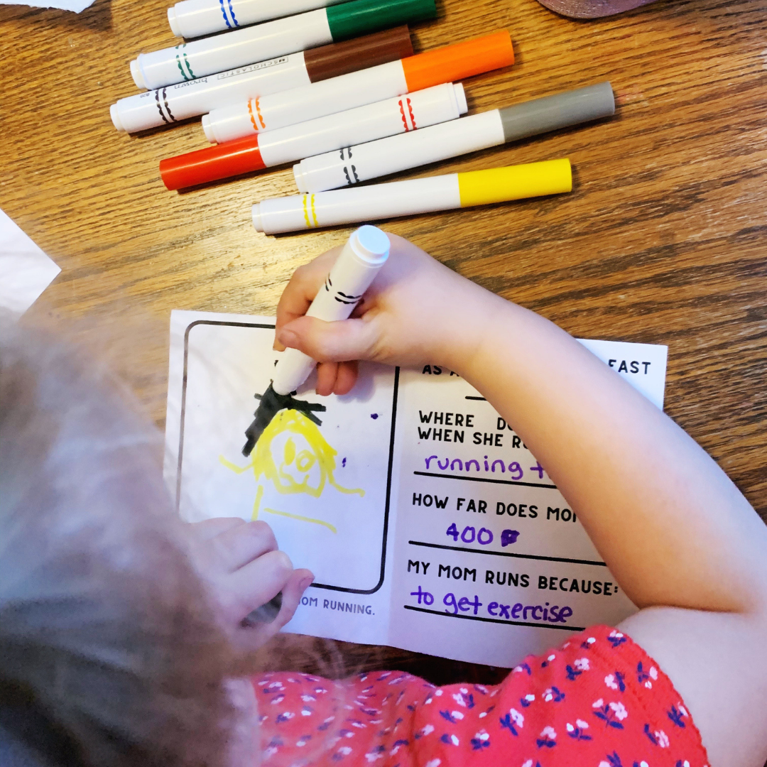 Young girl coloring a homemade card